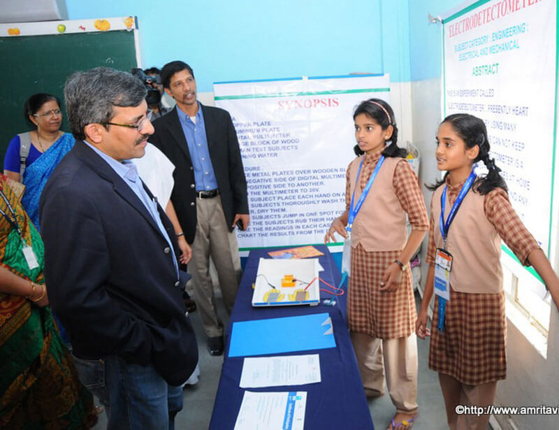 Former CBSE Chairman, Sri Vineet Joshi, IAS, interacting with  Amrita Vidyalayam students
